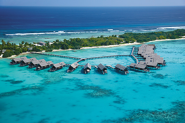Birdseye view of water villas on the Maldives Indian Ocean